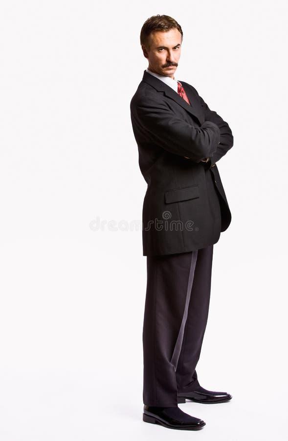 Homme d'affaires sévère avec des bras croisés photos stock