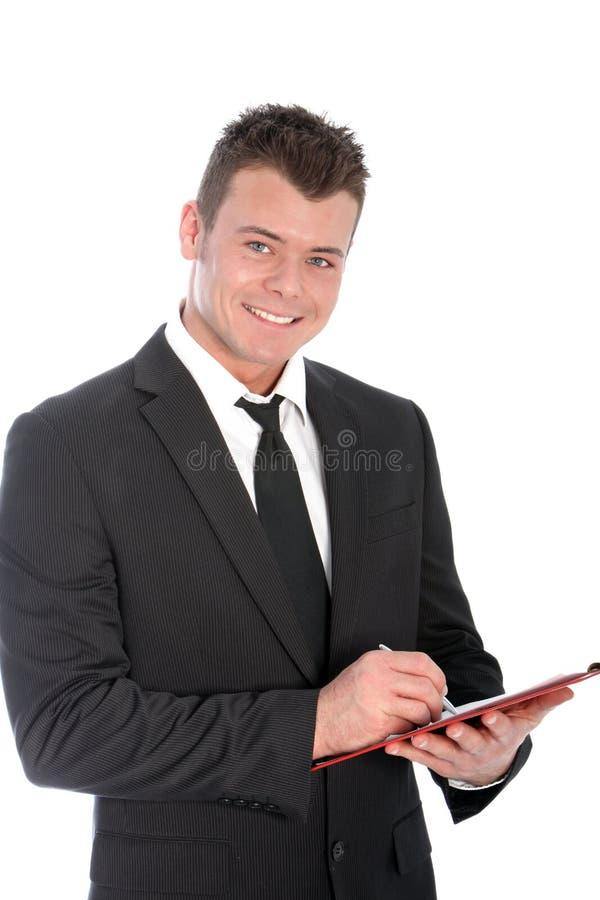Homme d'affaires sûr avec un presse-papiers photos stock