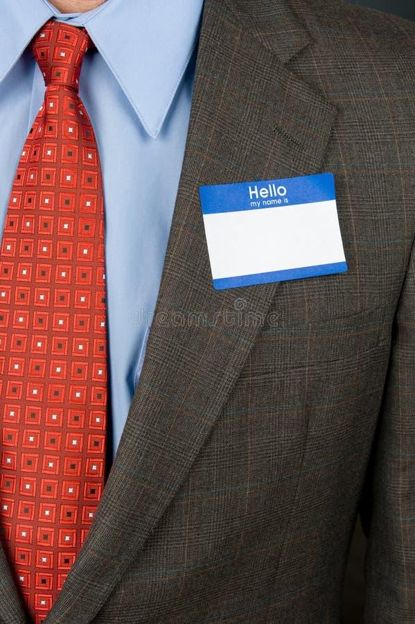 Homme d'affaires s'usant le nametag blanc photographie stock