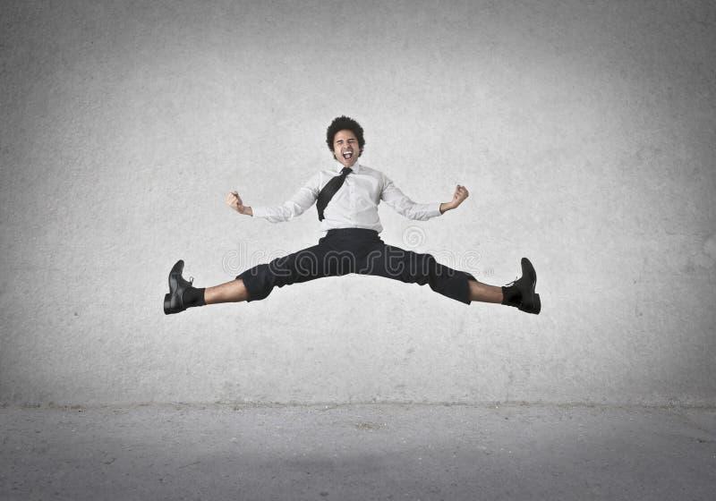 Homme d'affaires sautant image stock
