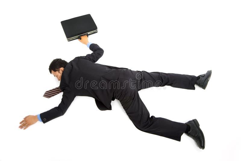 Homme d'affaires se couchant photographie stock libre de droits