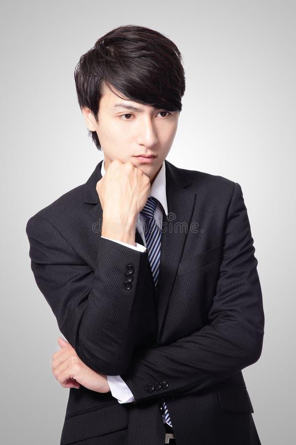 Homme d'affaires semblant déprimé images stock