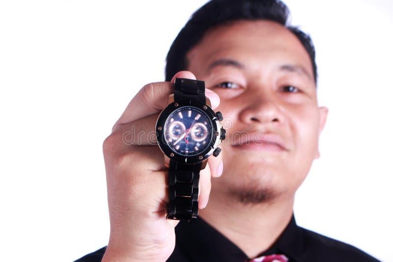 Homme d'affaires Showing Wristwatch image libre de droits