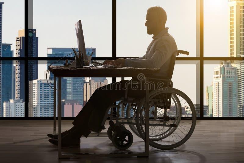 Homme d'affaires Sitting In Wheelchair photographie stock libre de droits