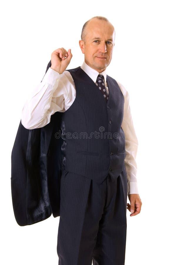 Homme d'affaires souriant dans le procès photographie stock libre de droits