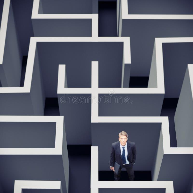 Homme d'affaires Stuck In un labyrinthe photographie stock libre de droits