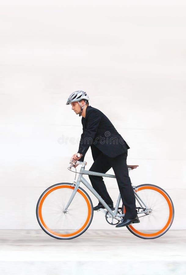 Homme d'affaires sur la bicyclette photos libres de droits