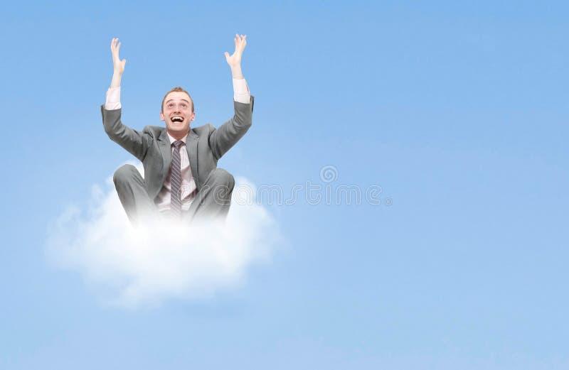 Homme d'affaires sur le nuage photographie stock