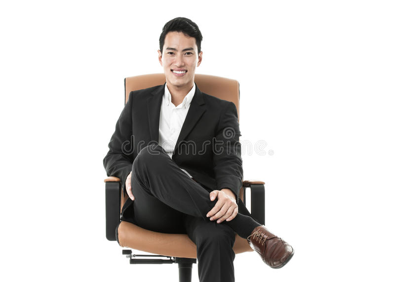 Homme d'affaires sur une chaise photos stock