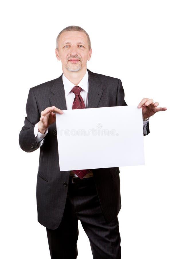 Homme d'affaires tenant la page du papier blanche photo stock
