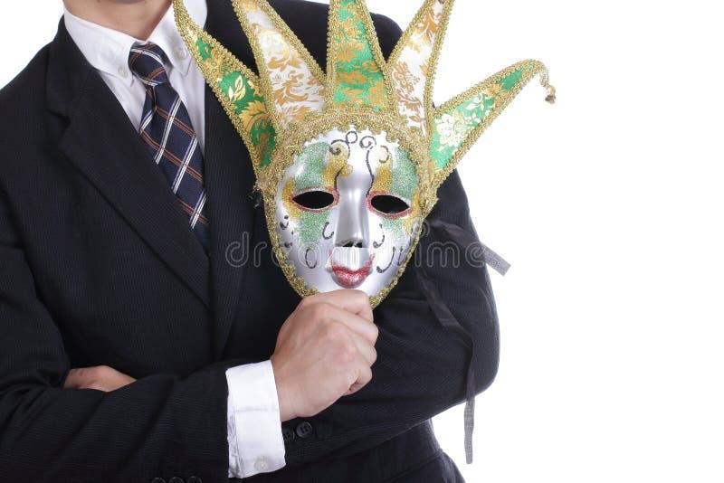 Homme d'affaires tenant le masque blanc photographie stock libre de droits
