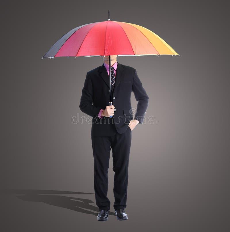 Download Homme D'affaires Tenant Le Parapluie D'arc-en-ciel Photo stock - Image du humain, conduite: 45363664