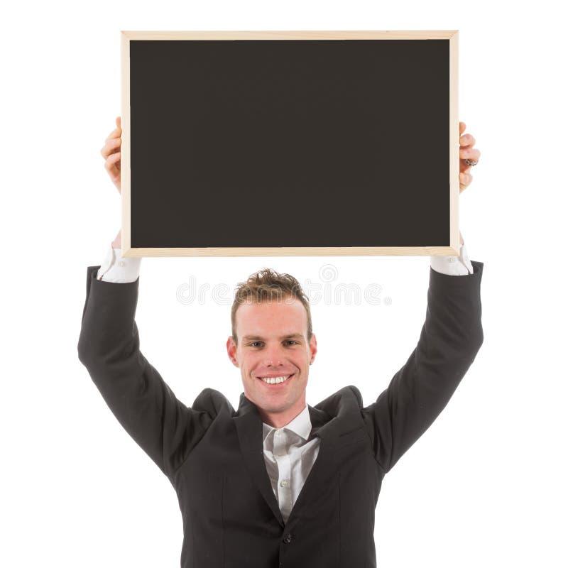 Homme d'affaires tenant le tableau vide au-dessus de sa tête images stock