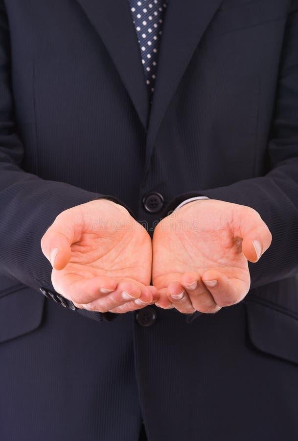 Homme d'affaires tenant les mains vides. photos stock
