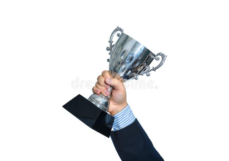 Homme d'affaires tenant un trophée d'argent de champion sur le fond blanc photos stock