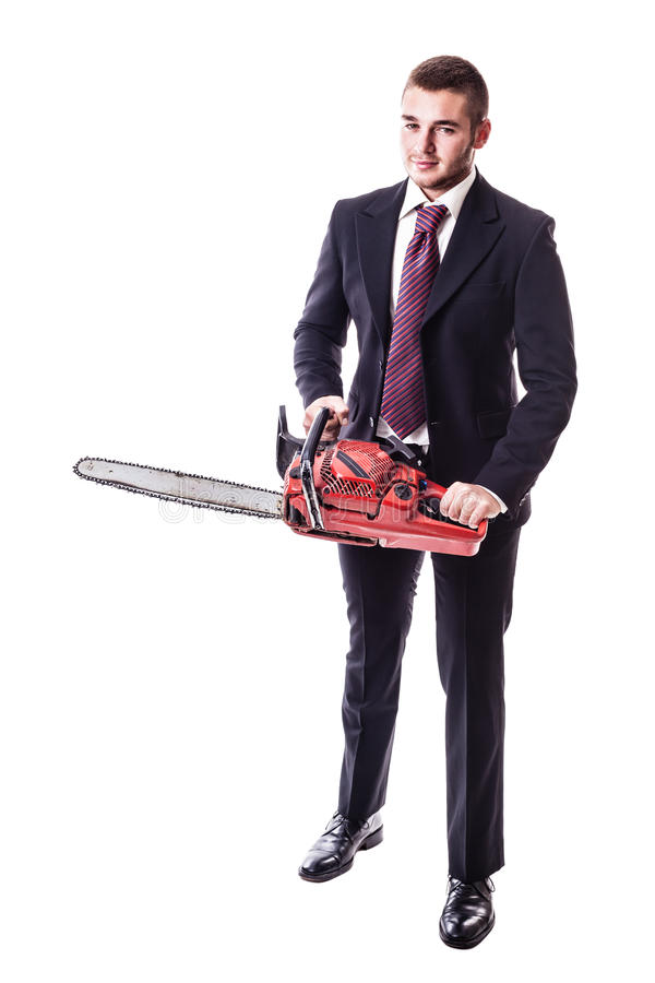Homme d'affaires tenant une tronçonneuse photo stock