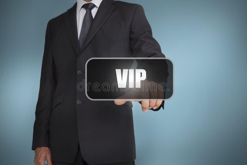 Homme d'affaires touchant le mot VIP photo libre de droits
