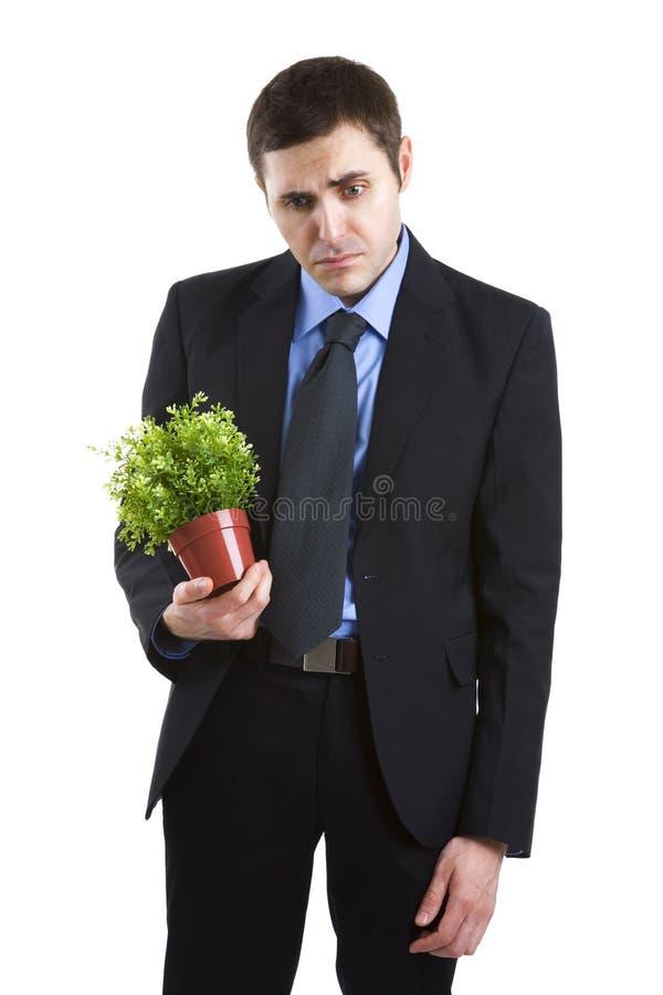 Homme d'affaires triste au-dessus du fond blanc images stock