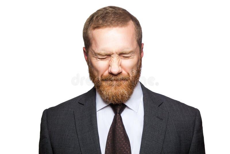Homme d'affaires triste malheureux avec les yeux fermés photo stock