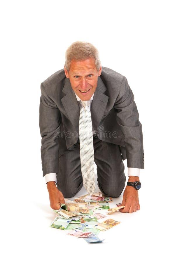 Homme d'affaires trouvant des euro photographie stock libre de droits