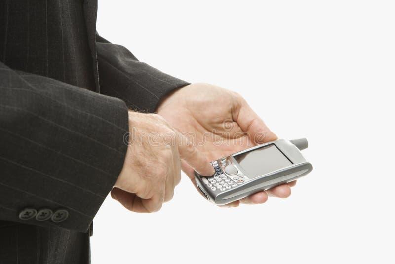 Homme d'affaires utilisant PDA photographie stock