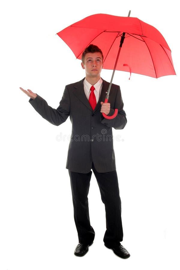 Homme d'affaires vérifiant la pluie images libres de droits