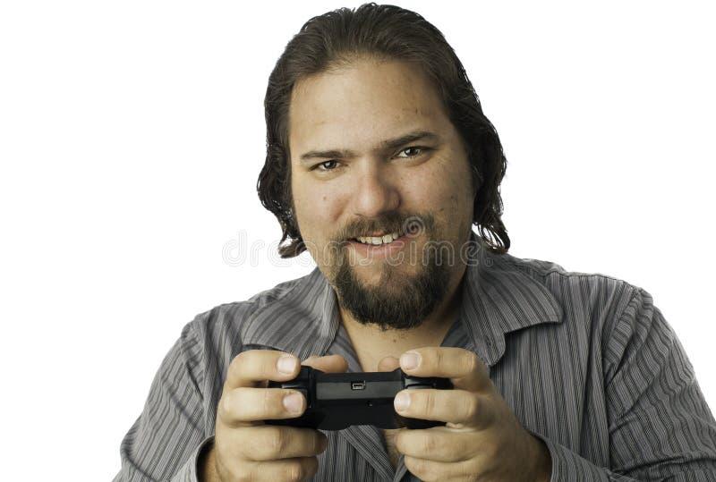 Homme d'isolement avec le contrôleur de jeu vidéo photographie stock libre de droits