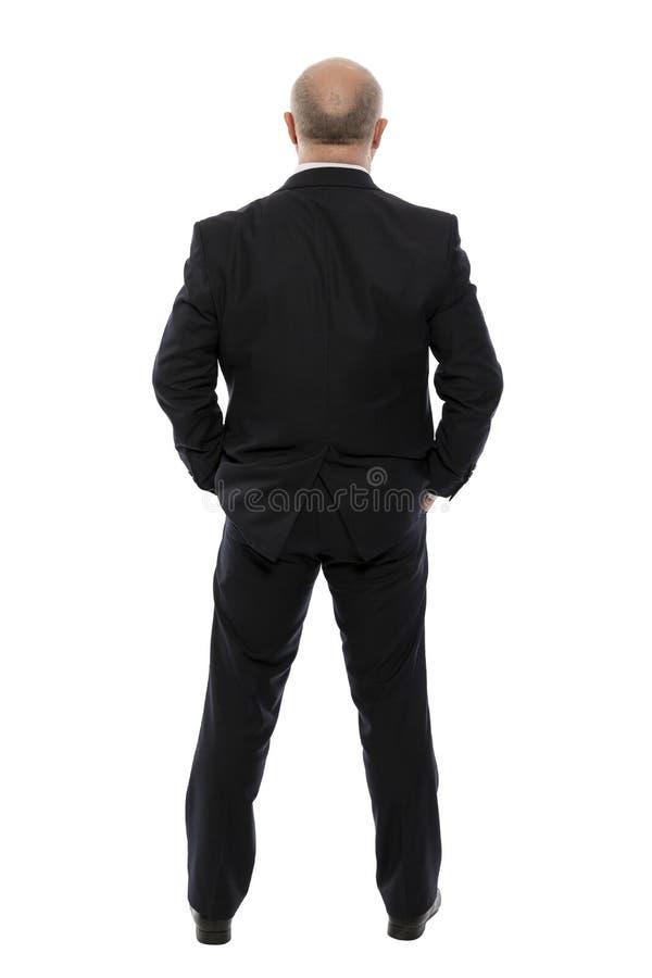 Homme d'une cinquantaine d'années chauve dans un costume, vue arrière, d'isolement sur le fond blanc image libre de droits