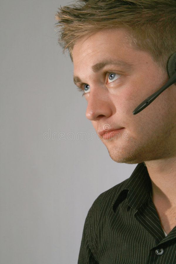 Homme dans l'écouteur photos stock