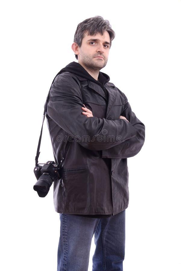 Homme dans l'appareil-photo noir de photo de jupe en cuir photo stock