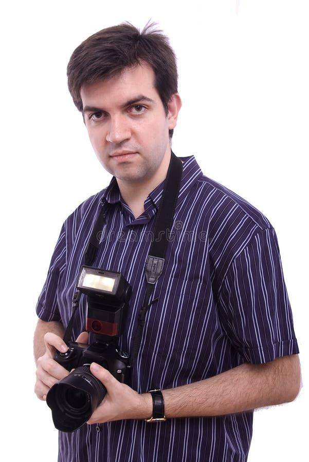 Homme dans la chemise avec un appareil-photo moderne de photo de SLR photo libre de droits