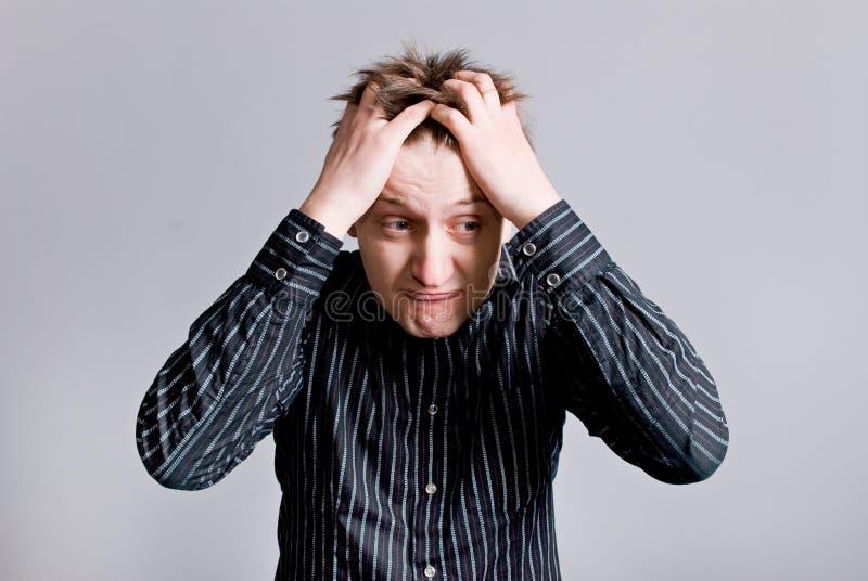 Homme dans la confusion photos stock