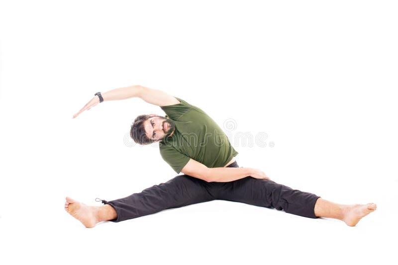 Homme dans la pose de fente image stock
