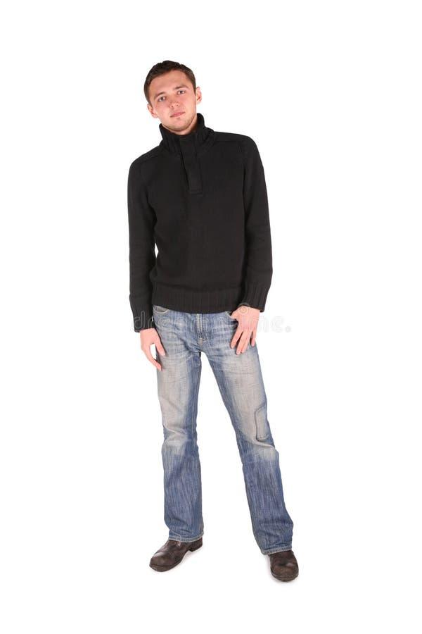 Homme dans la position noire de chemise photo stock