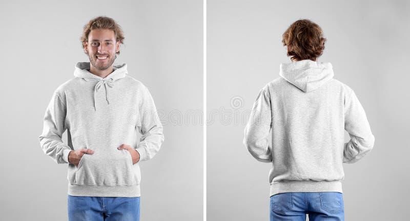 Homme dans le chandail vide de hoodie sur des vues de fond, avant et arrières légères photo libre de droits