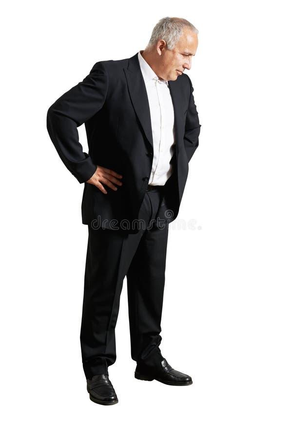 Homme dans le costume noir regardant vers le bas photographie stock