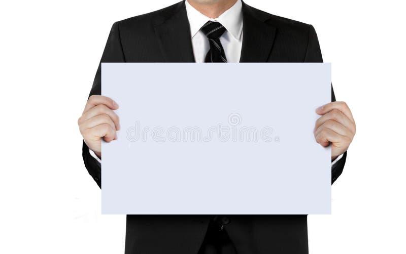 Homme dans le costume tenant le panneau vide de signe photo libre de droits