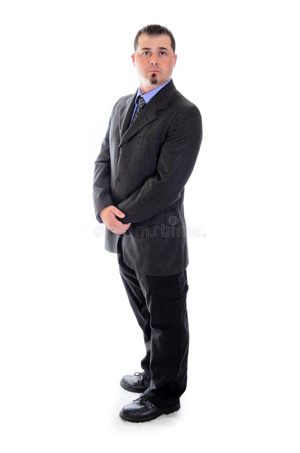 Homme dans le costume tenant ses mains photos stock