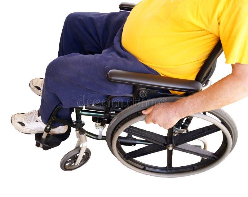 Homme dans le fauteuil roulant images stock