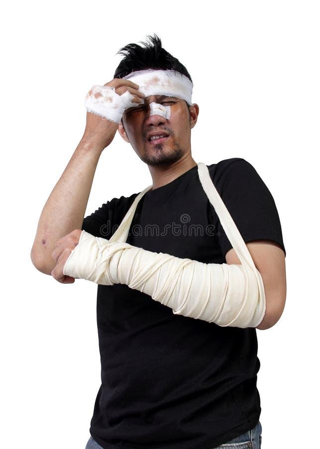 Homme dans le gémissement de bandage et de gypse d'isolement photo libre de droits