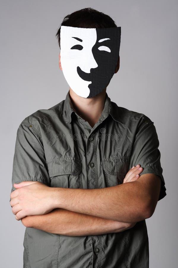 Homme dans le masque de sourire noir et blanc de théâtre image stock