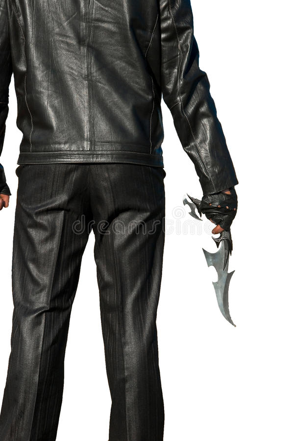 Homme dans le noir avec un couteau antique images libres de droits
