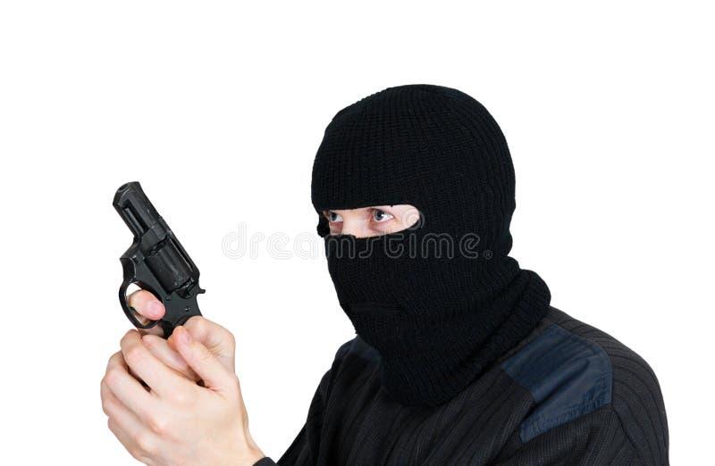 Homme dans un masque avec un canon photographie stock libre de droits