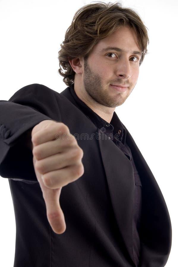 homme de désapprobation affichant le signe photos libres de droits