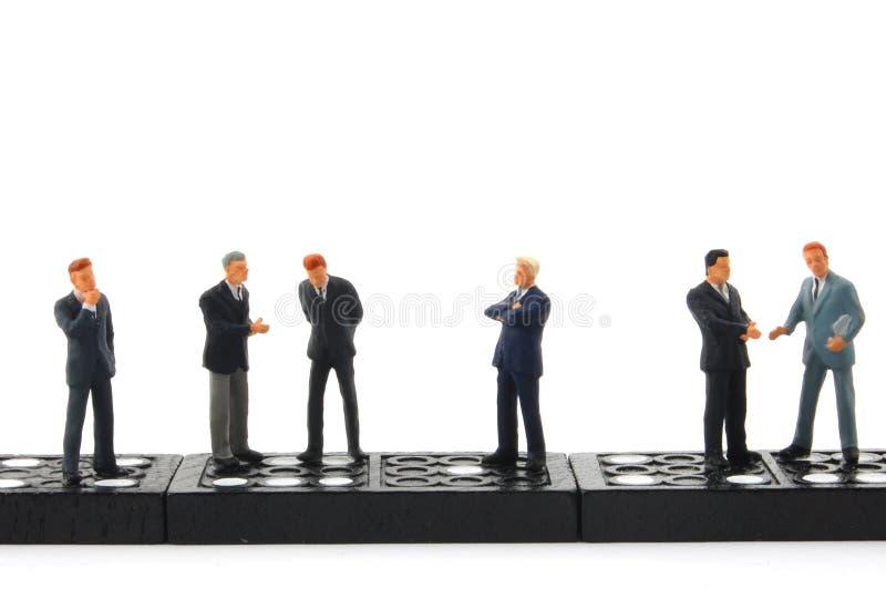 Download Homme de domino d'affaires photo stock. Image du miniature - 8650446