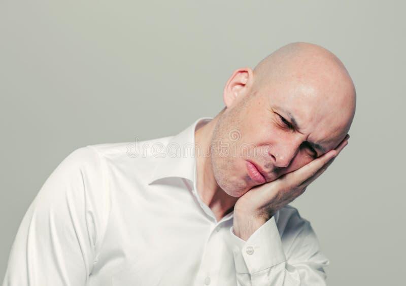 Homme de douleur de dents image stock