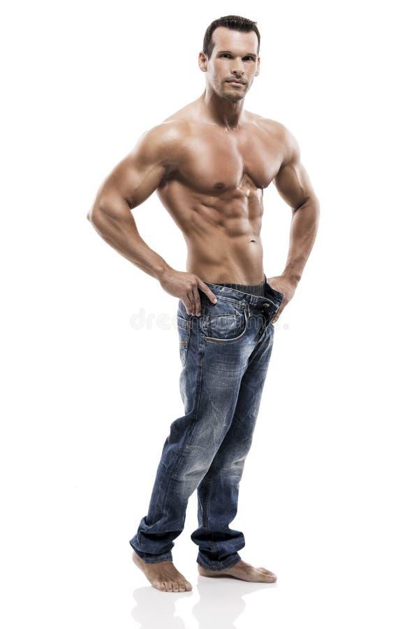 Homme de muscle posant dans le studio photo stock