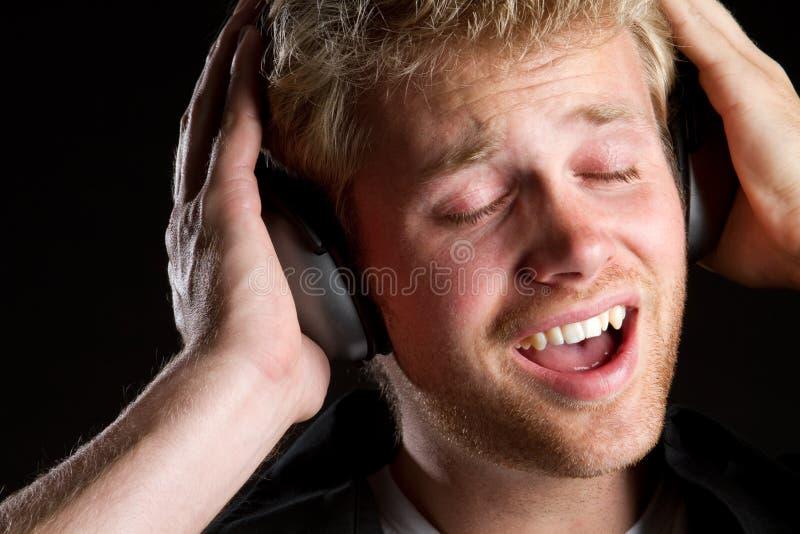 Homme de musique image stock