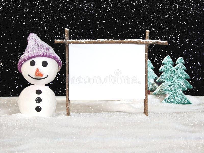 Homme de neige avec le signe image stock