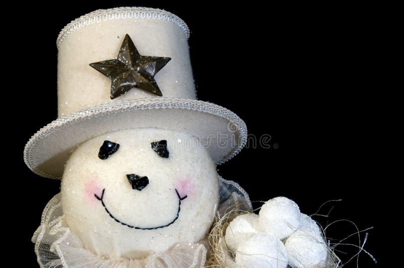 Homme de neige avec les billes et le chapeau de neige photographie stock libre de droits